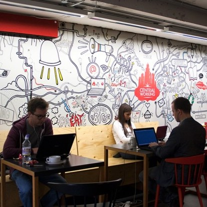 Young adults, working in a co-working environment.