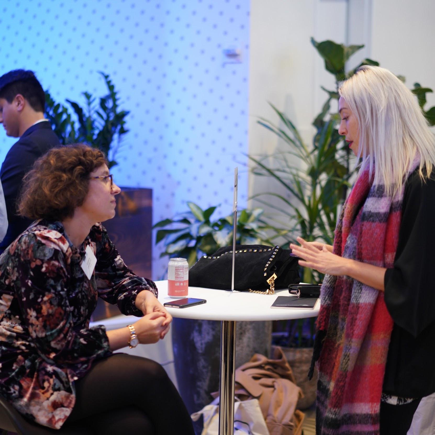 Women, discussing employment opportunities.